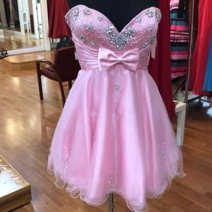 Pink prom dress with rhinestone flowers and bow